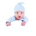 Funny newborn baby boy playing on his tummy little Royalty Free Stock Photo