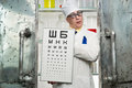 Funny oculist with a table in the laboratory Royalty Free Stock Photos