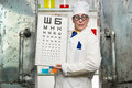 Funny oculist with a table in the laboratory Stock Photo