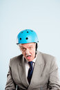 Funny old aged man wearing cycling helmet portrait Stock Image