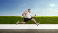 Funny overweight man on the run sportsman Stock Photo