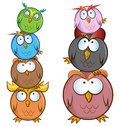Funny owl cartoon group isolated on white Stock Image
