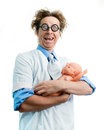 Funny pediatrician holding a baby Stock Photos