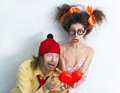 Funny people men and girl with a red heart in the hands Stock Image