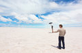 Funny photo because of spatial perspective on the lake salar de uyuni bolivia Royalty Free Stock Photos