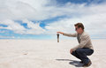 Funny photo because of spatial perspective on the lake salar de uyuni bolivia Stock Photos