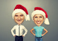 Funny picture of christmas couple over grey background Royalty Free Stock Photos