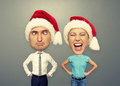 Funny picture of santa couple over grey background Stock Image