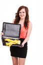 Funny picture of young business woman hiding her yellow rubber g gloves in a briefcase Stock Images