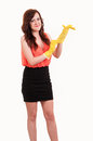 Funny picture of young business woman puting on hands yellow rub rubber glove Stock Image
