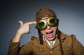 Funny pilot with goggles and helmet Stock Photography