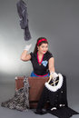Funny pinup girl packing her retro suitcase Royalty Free Stock Photography
