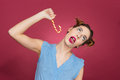Funny playful young woman having fun with candy cane Royalty Free Stock Photo