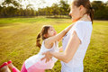 Funny playing lifestyle mum with daughter in pastime at the park outdoor Royalty Free Stock Image