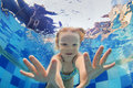 Funny portrait of baby girl swimming underwater in pool Royalty Free Stock Photo
