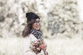 Funny positive young girl in winter white dress Royalty Free Stock Photo