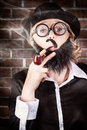Funny private eye detective smoking pipe prviate with wonky moe fake beard nerdy glasses and bowler hat at elementary my dear Royalty Free Stock Photos