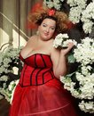 Funny Queen in red dress Royalty Free Stock Photo