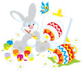 Funny rabbit drawing decorated easter egg to upcoming holiday Royalty Free Stock Photos