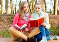 Funny reaction two young students reading something weird Stock Photography