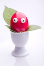 Funny red easter egg egg cup Stock Photography