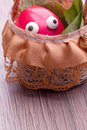Funny red easter egg eyes basket Royalty Free Stock Photos