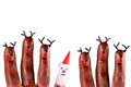 Funny reindeer and santa painted on fingers Stock Images