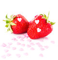 Funny ripe strawberry on white background decorated wi with sweet hearts closeup Stock Image