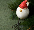 Funny santa bird on the green with xmas tree Stock Photo
