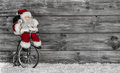 Funny Santa buying christmas presents decorated on wooden backgr Royalty Free Stock Photo