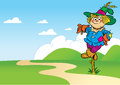 Funny scarecrow the illustration shows a cartoon which stands in a field near the road Royalty Free Stock Photo