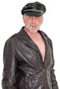 Funny scary tough guy biker and image of a man wearing leather clothes the dude is smoking a cigarette and has a scruffy beard and Stock Image