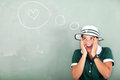 Funny schoolgirl love thinking about in classroom Royalty Free Stock Photography
