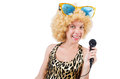 Funny singer woman with mic and sunglasses isolated on white Stock Photo