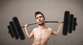 Funny skinny guy lifting weights incredible Royalty Free Stock Image