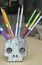 Funny skull shaped pencil holder with many colors Royalty Free Stock Photo