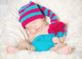Funny sleeping infant baby on white blanket Stock Images