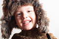 Funny smiling child in a fur hat fashion kid winter style little boy children portrait of Stock Image