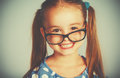 Funny smiling child girl in glasses Royalty Free Stock Photo