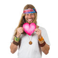 Funny smiling hippie holding a love heart