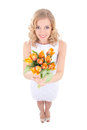 Funny smiling woman with orange tulips isolated on white Stock Photos