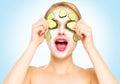 Funny spa woman applying fresh facial mask Royalty Free Stock Photo