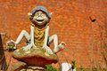 Funny statue of a troll jumping on mushroom Royalty Free Stock Photos