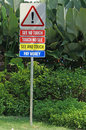 Funny street sign in sentosa island singapore Stock Photos