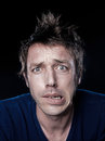 Funny stressed man portrait studio on black background of a expressive caucasian Stock Photography