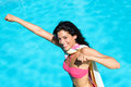 Funny super girl on summer vacation playful woman playing around in swimming pool happy having fun ready to jump to the water in Stock Photos