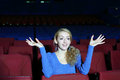Funny and surprised woman watches movie beautiful in theater Royalty Free Stock Photos