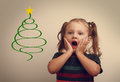 Funny surprising kid girl looking on fur tree illustration with open mouth Royalty Free Stock Photo