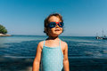 Funny swimmer girl on vacation at seaside Stock Images