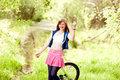 Funny teenager girl  with bicycle. Royalty Free Stock Photo